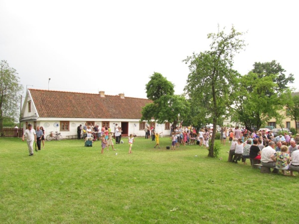 Family picnic organised by the Knyszyn Culture Centre at the backyard on and old house in Knyszyn